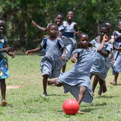 children playing with footballs